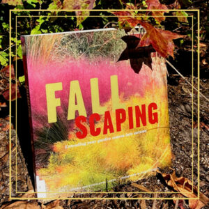 The book Fallscaping leaning against a Sweet Gum tree